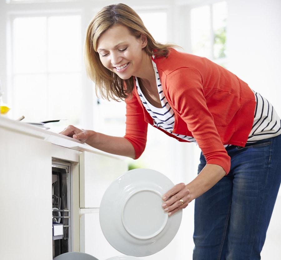 Woman-Packing-Dishwasher